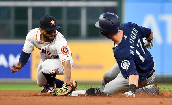<div class='meta'><div class='origin-logo' data-origin='none'></div><span class='caption-text' data-credit='AP Photo/Eric Christian Smith'>Seattle Mariners' Mitch Haniger (17) slides safely into second for a double against Houston Astros second baseman Jose Altuve during the fourth inning of the baseball game.</span></div>