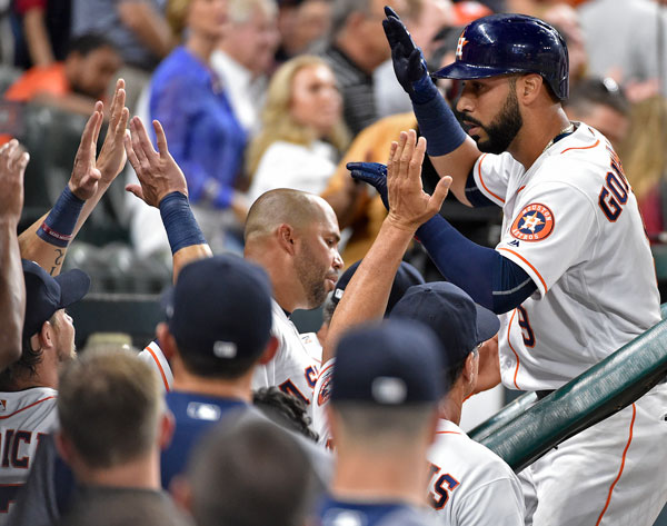 <div class='meta'><div class='origin-logo' data-origin='none'></div><span class='caption-text' data-credit='AP Photo/Eric Christian Smith'>Houston Astros' Marwin Gonzalez, right, celebrates his solo home run off Seattle Mariners starting pitcher Hisashi Iwakuma during the sixth inning of the game.</span></div>