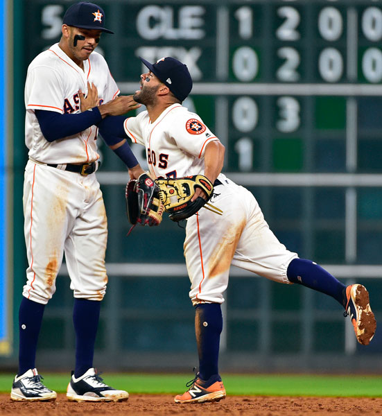 <div class='meta'><div class='origin-logo' data-origin='none'></div><span class='caption-text' data-credit='AP Photo/Eric Christian Smith'>Houston Astros' Jose Altuve, right, and Carlos Correa celebrate the team's 2-1 win over the Seattle Mariners in a baseball game, Tuesday, April 4, 2017, in Houston.</span></div>