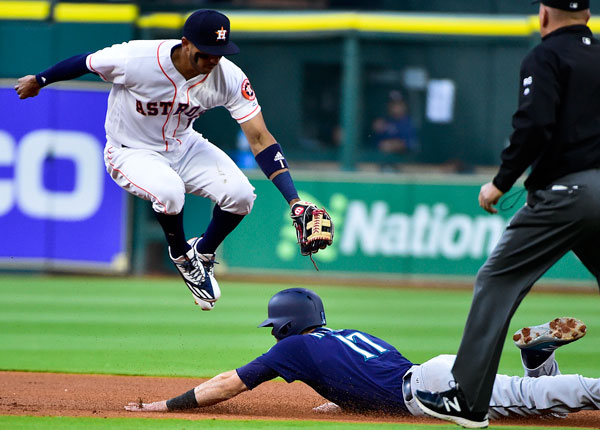 <div class='meta'><div class='origin-logo' data-origin='none'></div><span class='caption-text' data-credit='AP Photo/Eric Christian Smith'>Seattle Mariners' Mitch Haniger, bottom, steals second base under Houston Astros shortstop Carlos Correa in the first inning of a baseball game, Wednesday, April 5, 2017.</span></div>