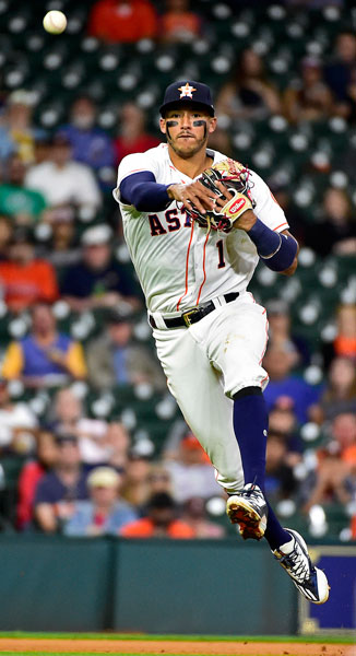 <div class='meta'><div class='origin-logo' data-origin='none'></div><span class='caption-text' data-credit='AP Photo/Eric Christian Smith'>Houston Astros shortstop Carlos Correa throws out Seattle Mariners' Mike Zunino to end the top half of the fourth inning of a baseball game, Wednesday, April 5, 2017, in Houston.</span></div>