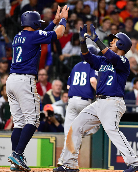 <div class='meta'><div class='origin-logo' data-origin='none'></div><span class='caption-text' data-credit='AP Photo/Eric Christian Smith'>Seattle Mariners' Jean Segura (2) celebrates his two-run home run off Houston Astros starting pitcher Charlie Morton with Leonys Martin in the fifth inning of a baseball game.</span></div>
