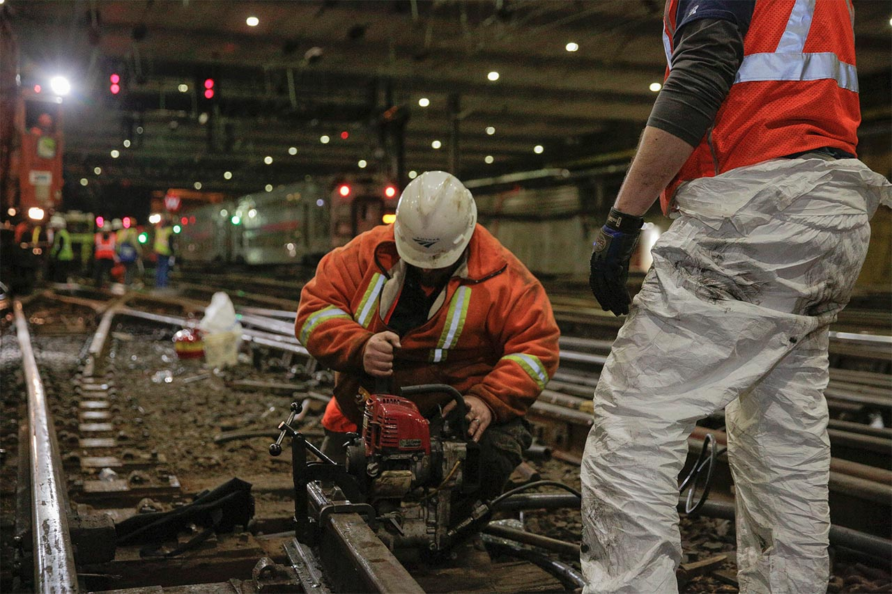 <div class='meta'><div class='origin-logo' data-origin='none'></div><span class='caption-text' data-credit='Photo/Amtrak'>An Amtrak track worker cuts out a railroad tie for replacement at New York Penn Station.</span></div>