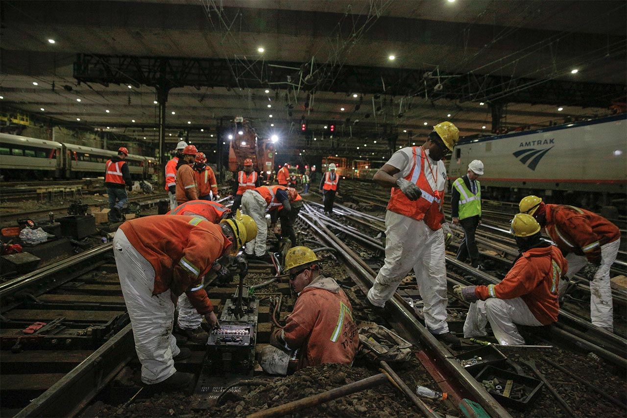 <div class='meta'><div class='origin-logo' data-origin='none'></div><span class='caption-text' data-credit='Photo/Amtrak'>Amtrak track workers wire a replacement switch machine that allows trains to move between the tracks at New York Penn Station.</span></div>