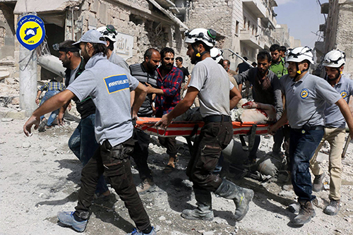 "<div class=""meta image-caption""><div class=""origin-logo origin-image ap""><span>AP</span></div><span class=""caption-text"">Rescue workers work the site of airstrikes in the al-Sakhour neighborhood of the rebel-held part of eastern Aleppo, Syria. (Syrian Civil Defense White Helmets via AP, File)</span></div>"