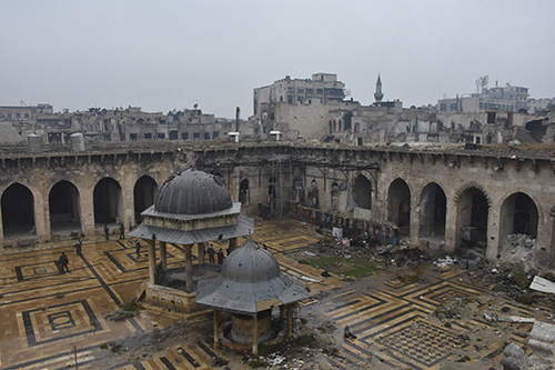 "<div class=""meta image-caption""><div class=""origin-logo origin-image ap""><span>AP</span></div><span class=""caption-text"">Syrian troops and pro-government gunmen marching walk inside the destroyed Grand Umayyad mosque in the old city of Aleppo, Syria, Tuesday, Dec. 13, 2016. (SANA via AP)</span></div>"
