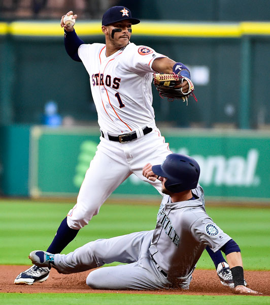 "<div class=""meta image-caption""><div class=""origin-logo origin-image none""><span>none</span></div><span class=""caption-text"">Houston Astros shortstop Carlos Correa (1) turns a double play over Seattle Mariners' Mitch Haniger in the first inning of a baseball game, Thursday, April 6, 2017, in Houston. (AP Photo/Eric Christian Smith)</span></div>"