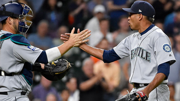 "<div class=""meta image-caption""><div class=""origin-logo origin-image none""><span>none</span></div><span class=""caption-text"">Seattle Mariners relief pitcher Edwin Diaz, right, clasps hands with catcher Mike Zunino after striking out Houston Astros' Norichika Aoki to end a baseball game. Seattle won 4-2. (AP Photo/Eric Christian Smith)</span></div>"
