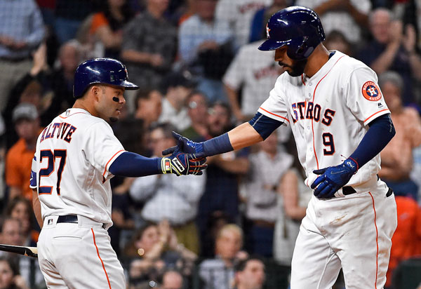 "<div class=""meta image-caption""><div class=""origin-logo origin-image none""><span>none</span></div><span class=""caption-text"">Houston Astros' Marwin Gonzalez (9) celebrates with Jose Altuve after Gonzalez's solo home run off Seattle Mariners starting pitcher Ariel Miranda during the fourth inning. (AP Photo/Eric Christian Smith)</span></div>"