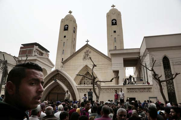 <div class='meta'><div class='origin-logo' data-origin='AP'></div><span class='caption-text' data-credit='AP'>People gather outside the St. George's Church after a suicide bombing, in the Nile Delta town of Tanta, Egypt, Sunday, April 9, 2017.  (AP Photo/Nariman El-Mofty)</span></div>