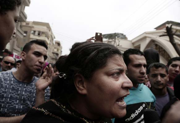<div class='meta'><div class='origin-logo' data-origin='AP'></div><span class='caption-text' data-credit='AP'>A woman talks to a journalist outside the St. George's Church after a deadly suicide bombing, in the Nile Delta town of Tanta, Egypt. (AP Photo/Nariman El-Mofty)</span></div>
