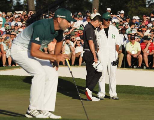"<div class=""meta image-caption""><div class=""origin-logo origin-image ap""><span>AP</span></div><span class=""caption-text"">Justin Rose, of England, can't watch as Sergio Garcia, of Spain, lines up his birdie putt on the 18th hole during the final round. (AP Photo/David J. Phillip) (AP)</span></div>"