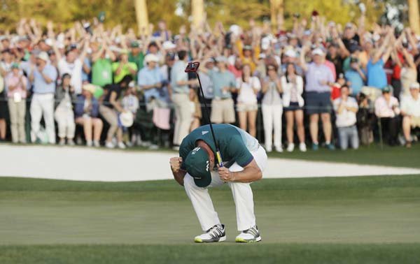 "<div class=""meta image-caption""><div class=""origin-logo origin-image ap""><span>AP</span></div><span class=""caption-text"">Sergio Garcia, of Spain, reacts after making his birdie putt on the 18th green to win the Masters golf tournament after a playoff Sunday.(AP Photo/David J. Phillip) (AP)</span></div>"