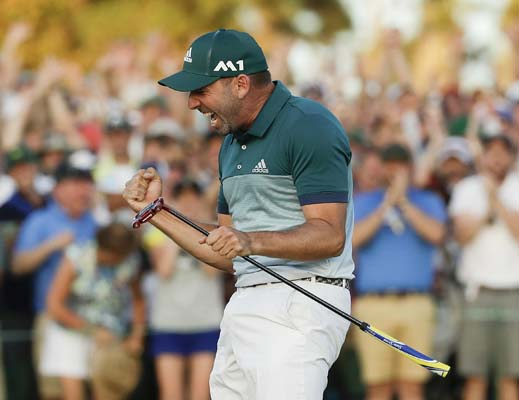 "<div class=""meta image-caption""><div class=""origin-logo origin-image ap""><span>AP</span></div><span class=""caption-text"">Sergio Garcia, of Spain, reacts after making his birdie putt on the 18th green to win the Masters golf tournament after a playoff Sunday. (AP Photo/Matt Slocum) (AP)</span></div>"