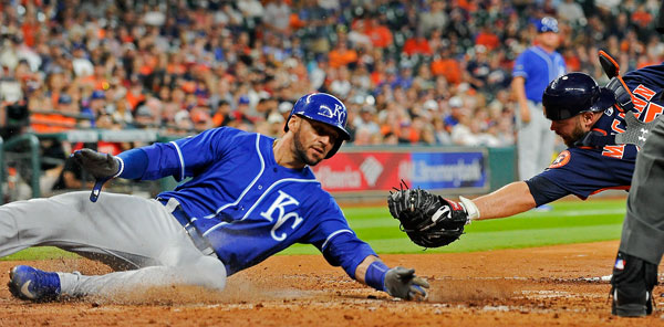 <div class='meta'><div class='origin-logo' data-origin='none'></div><span class='caption-text' data-credit='AP Photo/Eric Christian Smith'>Kansas City Royals' Paulo Orlando, left, slides safely past Houston Astros catcher Brian McCann to score on a sacrifice bunt by Raul Mondesi in the fifth inning.</span></div>