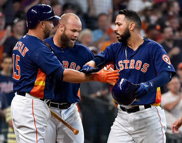 "<div class=""meta image-caption""><div class=""origin-logo origin-image none""><span>none</span></div><span class=""caption-text"">Houston Astros Marwin Gonzalez, right, celebrates his game-tying two-run home run off Kansas City Royals starting pitcher Travis Wood with Carlos Beltran, left, and Evan Gattis. (AP Photo/Eric Christian Smith)</span></div>"