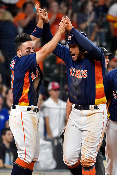 "<div class=""meta image-caption""><div class=""origin-logo origin-image none""><span>none</span></div><span class=""caption-text"">Houston Astros' George Springer, right, celebrates scoring the winning run on Evan Gattis' bases-loaded walk with Jose Altuve in the 12th inning of the game. (AP Photo/Eric Christian Smith)</span></div>"