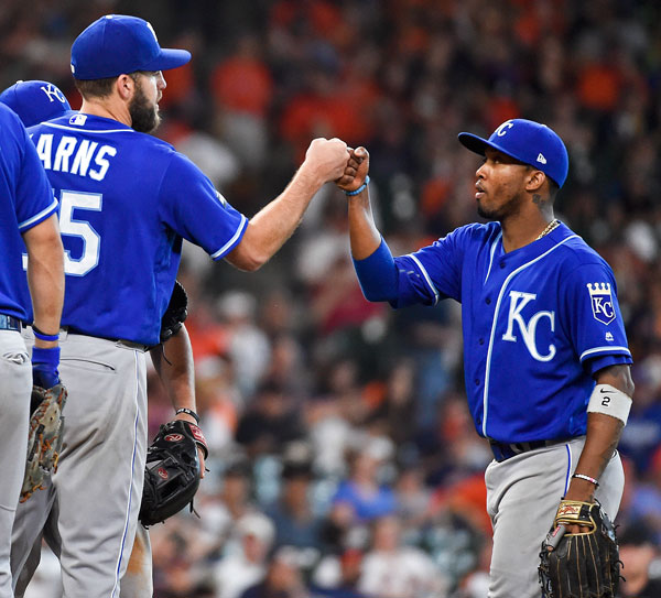 <div class='meta'><div class='origin-logo' data-origin='none'></div><span class='caption-text' data-credit='AP Photo/Eric Christian Smith'>Kansas City Royals starting pitcher Nathan Karns, left, gives a fist bump to shortstop Alcides Escobar after Karns was removed from the baseball game in the sixth inning.</span></div>
