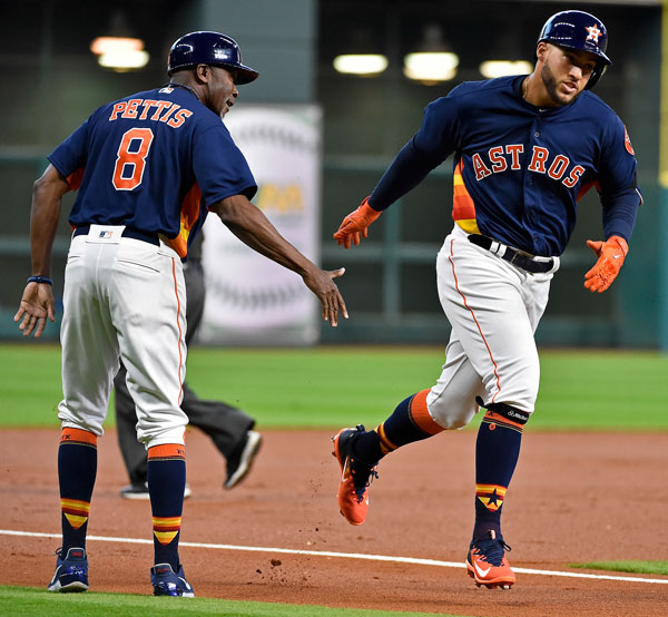 "<div class=""meta image-caption""><div class=""origin-logo origin-image none""><span>none</span></div><span class=""caption-text"">Houston Astros' George Springer, right, shakes hands with third base coach Gary Pettis after hitting a solo home run off Kansas City Royals starting pitcher Nathan Karns. (AP Photo/Eric Christian Smith)</span></div>"