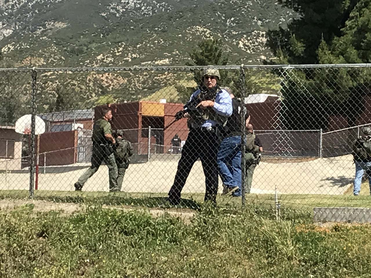"<div class=""meta image-caption""><div class=""origin-logo origin-image none""><span>none</span></div><span class=""caption-text"">Police lined the perimeter of North Park elementary following a shooting inside a classroom. (Photo/Rick Sforza with Southern California News Group)</span></div>"