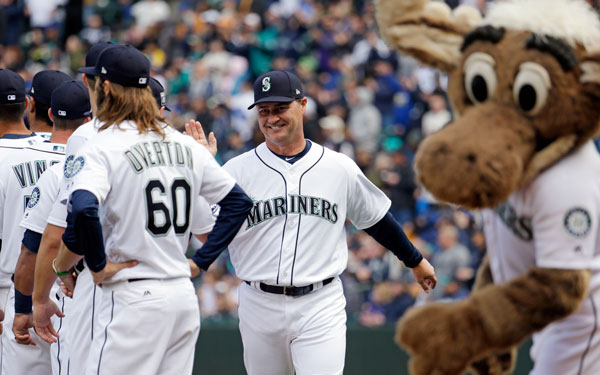 <div class='meta'><div class='origin-logo' data-origin='none'></div><span class='caption-text' data-credit='AP Photo/Elaine Thompson'>Seattle Mariners manager Scott Servais greets players before a baseball game between the Mariners and Houston Astros Monday, April 10, 2017, in Seattle.</span></div>