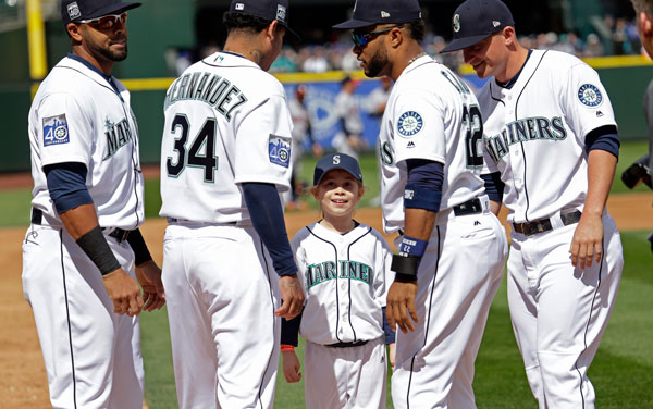 <div class='meta'><div class='origin-logo' data-origin='none'></div><span class='caption-text' data-credit='AP Photo/Elaine Thompson'>Sophia Robinson, 8, is greeted at home after her ceremonial run around the bases by Seattle Mariners Nelson Cruz, left, Felix Hernandez, Robinson Cano and Kyle Seager.</span></div>