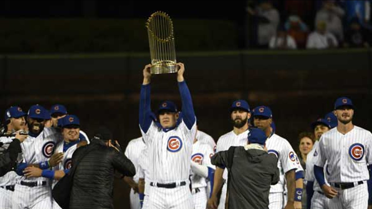 Chicago Cubs first baseman Anthony Rizzo (44) carries the 2016 World Series Championship trophy on home opening day.