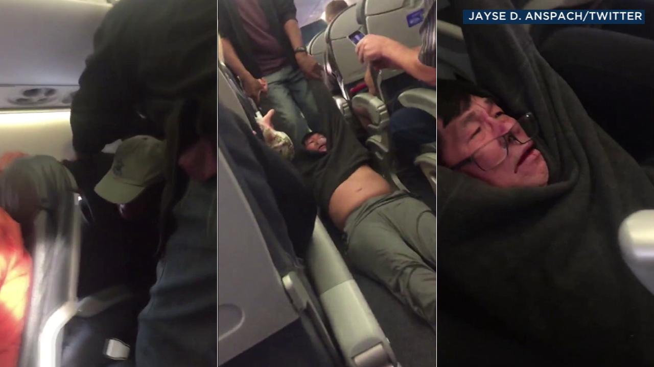 Video shows security officials dragging a passenger from a United Airlines flight that the airline said was overbooked as it waited to depart from Chicago.