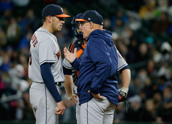 "<div class=""meta image-caption""><div class=""origin-logo origin-image none""><span>none</span></div><span class=""caption-text"">Houston Astros starting pitcher Joe Musgrove, left, and catcher Brian McCann talk with pitching coach Brent Strom, right, during the fifth inning. (AP Photo/Ted S. Warren)</span></div>"