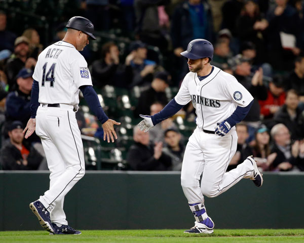 "<div class=""meta image-caption""><div class=""origin-logo origin-image none""><span>none</span></div><span class=""caption-text"">Seattle Mariners' Mike Freeman, right, is congratulated by third base coach Manny Acta on his home run against the Houston Astros in the second inning of the game. (AP Photo/Elaine Thompson)</span></div>"