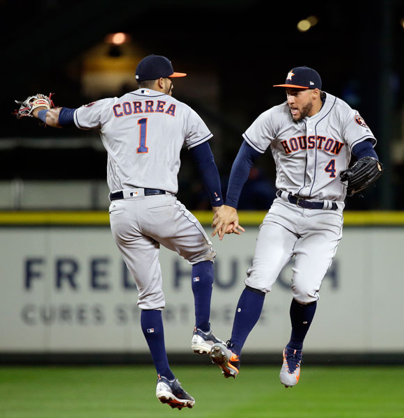 "<div class=""meta image-caption""><div class=""origin-logo origin-image none""><span>none</span></div><span class=""caption-text"">Houston Astros' Carlos Correa (1) and George Springer share congratulations after the team defeated the Seattle Mariners 10-5 in a baseball game Wednesday, April 12, 2017. (AP Photo/Elaine Thompson)</span></div>"