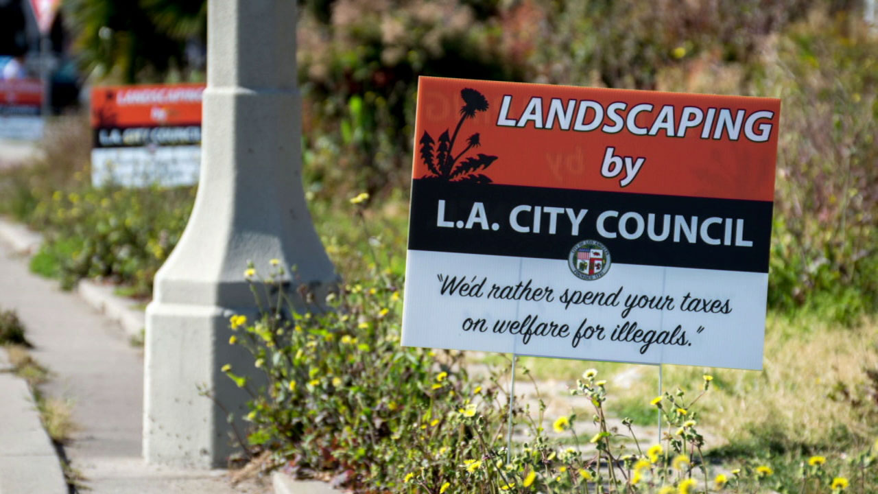 A photo shows a prank sign posted in Beverly Hills on a median overgrown with about 2 feet of weeds on Friday, April 14, 2017.