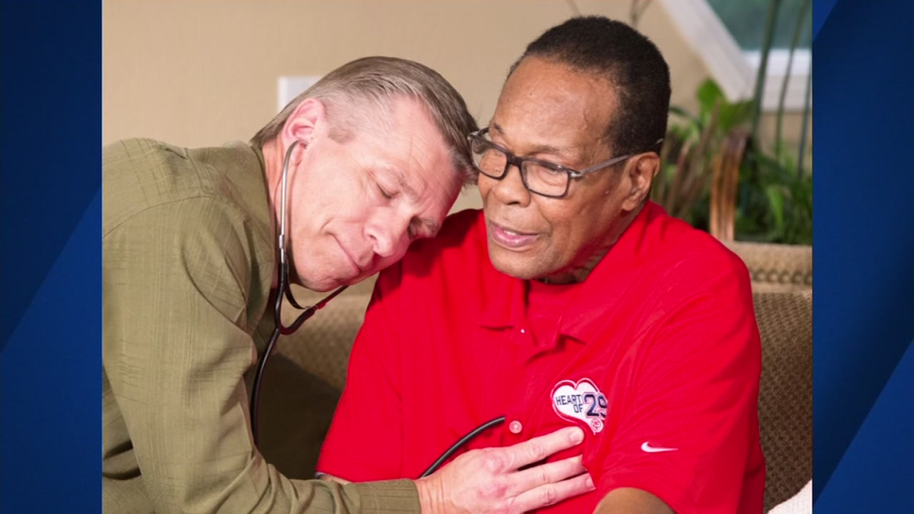 Konrad Reuland is seen listening to his son's heart beat inside of Baseball Hall-of-Famer Rod Carew after an organ transplant in this undated image.