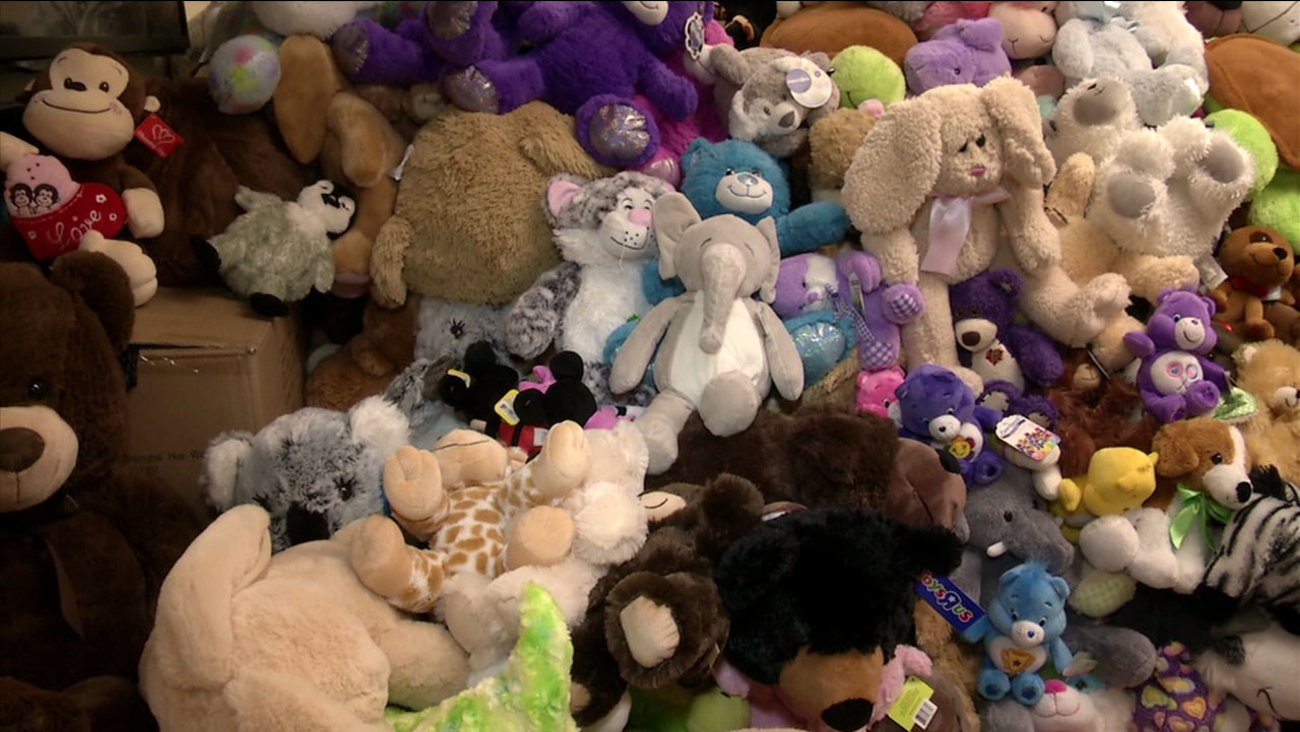 Hundreds of stuffed animals are shown after people donated the toys as part of a drive to help the students affected in the San Bernardino school shooting.