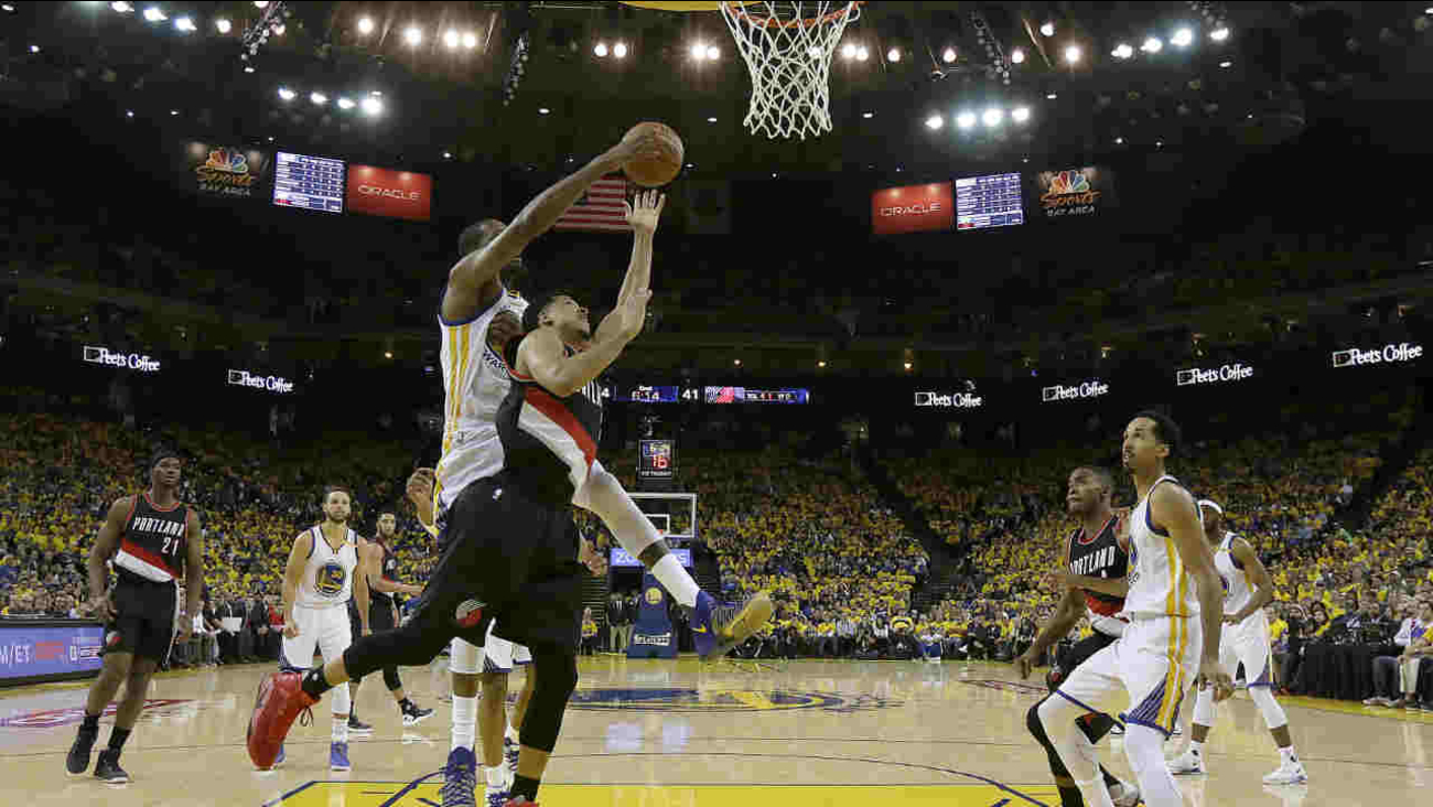 Portland Trail Blazers guard C.J. McCollum, shoots in front of Golden State Warriors forward Kevin Durant during Game 1 of the NBA Playoffs on Sunday, April 16, 2017.