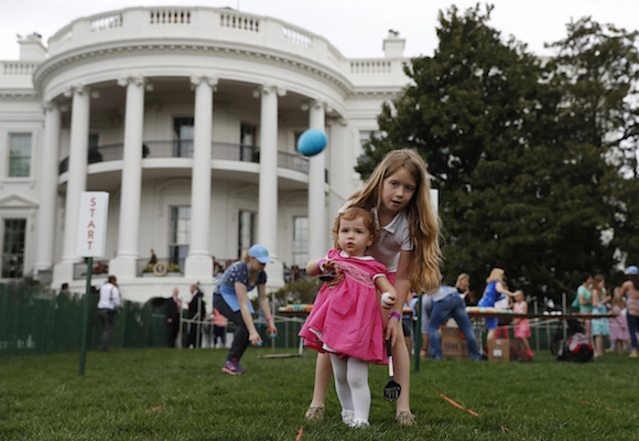 <div class='meta'><div class='origin-logo' data-origin='Creative Content'></div><span class='caption-text' data-credit='AP Photo/Carolyn Kaster'>Eggs fly as Caroline Earnshaw, 10, helps her sister Brooke Earnshaw, 2, during the White House Easter Egg Roll on the South Lawn of the White House in Washington, Monday, April,17.</span></div>