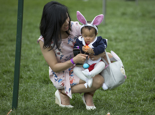 <div class='meta'><div class='origin-logo' data-origin='Creative Content'></div><span class='caption-text' data-credit='AP Photo/Carolyn Kaster'>Eleven-month-old Victoria Cheng and her mother Guliana Cheng, both from San Francisco, prepare to participate in the White House Easter Egg Roll.</span></div>