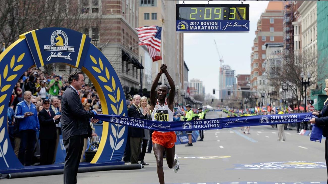 Geoffrey Kirui, of Kenya, crosses the finish line to win the 121st Boston Marathon on Monday, April 17, 2017, in Boston.