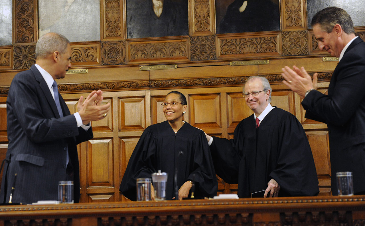 <div class='meta'><div class='origin-logo' data-origin='AP'></div><span class='caption-text' data-credit='AP Photo/Hans Pennink'>U.S. Attorney General Eric Holder left, and Lt. Gov. Robert J. Duffy, right, applaud after Court of Appeals judge Sheila Abdus-Salaam, second from left, is congratulated.</span></div>