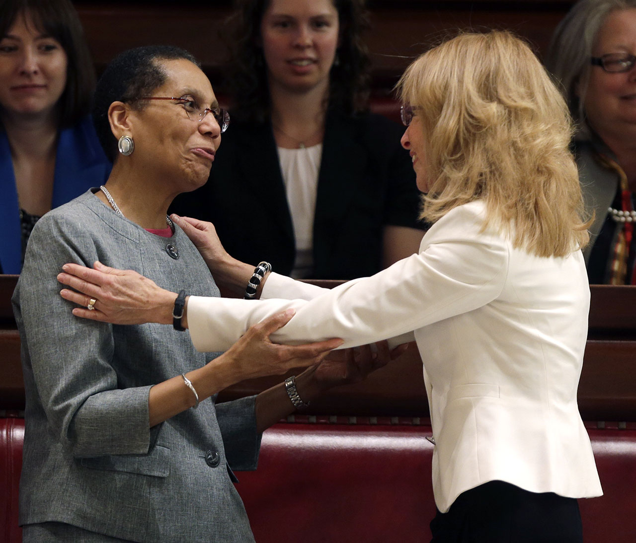 <div class='meta'><div class='origin-logo' data-origin='AP'></div><span class='caption-text' data-credit='AP Photo/Mike Groll'>Justice Sheila Abdus-Salaam, left, is congratulated after being confirmed to serve on the New York State Court of Appeals by friend and Albany City Court Judge Rachel Kretser.</span></div>