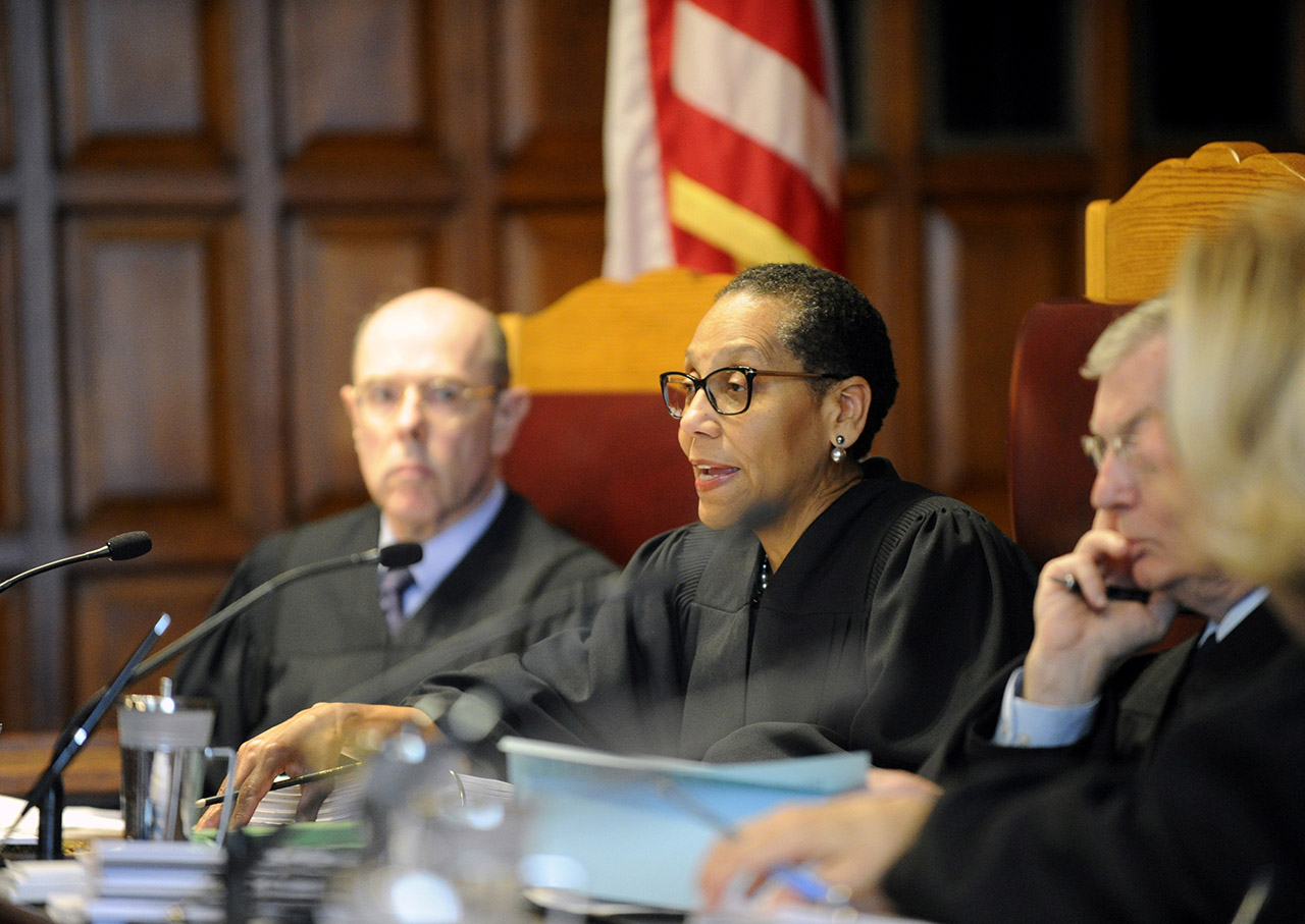 <div class='meta'><div class='origin-logo' data-origin='AP'></div><span class='caption-text' data-credit='AP Photo/Hans Pennink'>Sheila Abdus-Salaam, center, listens to oral arguments on whether criminal defendants should be allowed to use allegations made in civil rights lawsuits against police witnesses.</span></div>