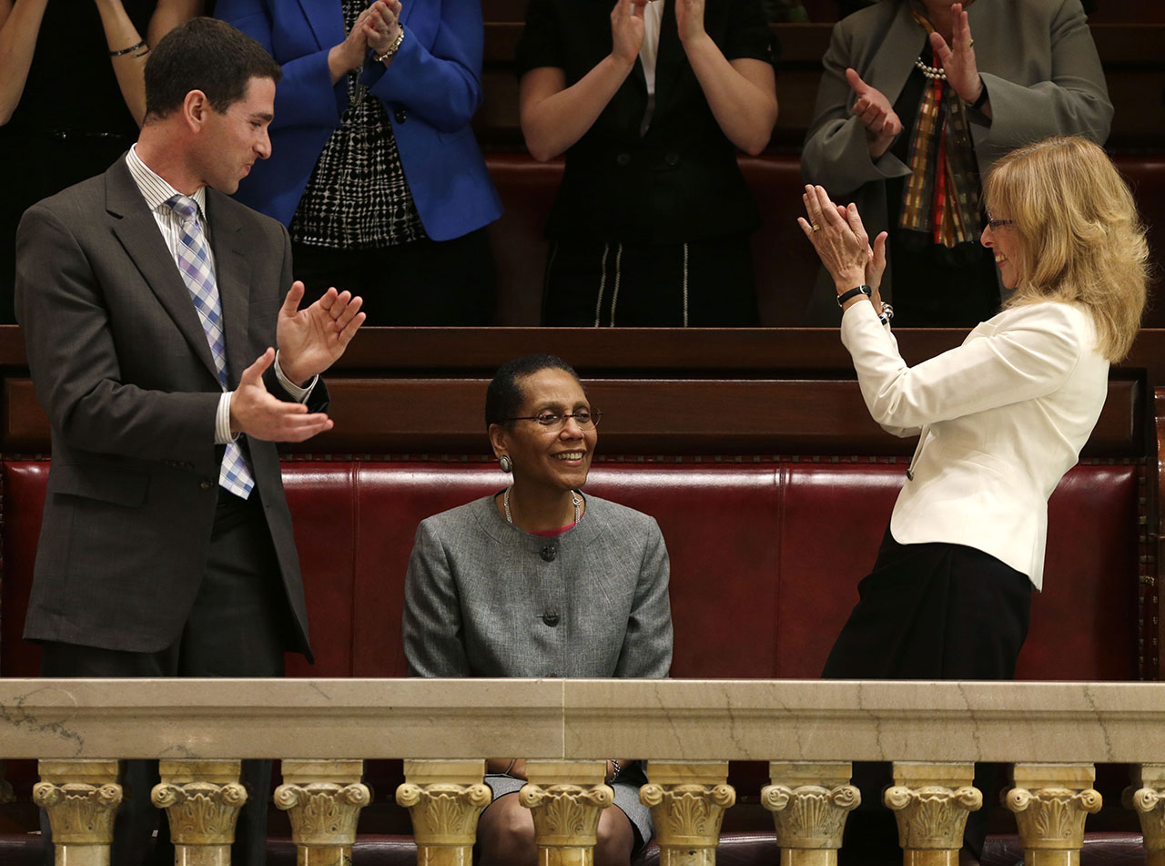 <div class='meta'><div class='origin-logo' data-origin='AP'></div><span class='caption-text' data-credit='AP Photo/Mike Groll'>Justice Sheila Abdus-Salaam, center, receives applause after her confirmation to serve on the New York State Court of Appeals on Monday, May 6, 2013.</span></div>