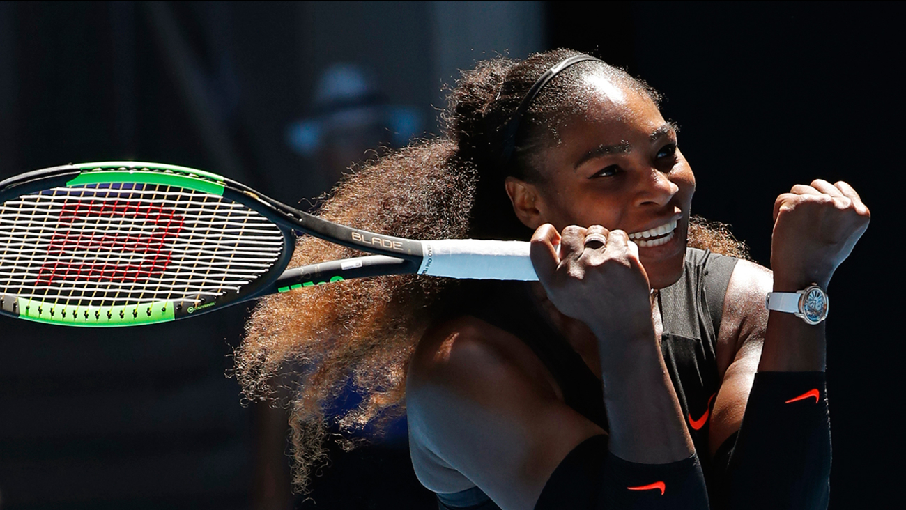 Serena Williams celebrates win over Britain's Johanna Konta during their quarterfinal at the Australian Open tennis championships in Melbourne, Australia, Wednesday, Jan. 25, 2017.