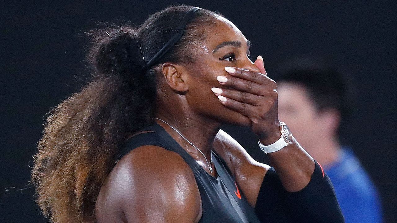 United States' Serena Williams covers her face after defeating her sister, Venus, in the women's singles final at the Australian Open tennis championships in Melbourne, Australia, Saturday, Jan. 28, 2017.