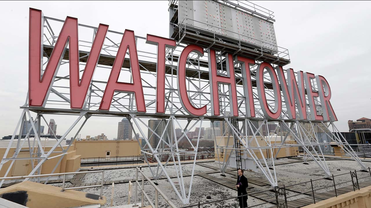 Watchtower sign is seen on the roof of 25-30 Columbia Heights, the current world headquarters of the Jehovah's Witnesses, in the Brooklyn borough of New York.