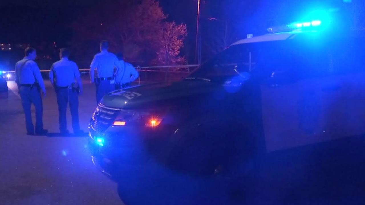 Police investigate at the scene.