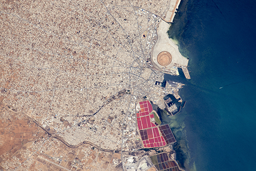 "<div class=""meta image-caption""><div class=""origin-logo origin-image none""><span>none</span></div><span class=""caption-text"">The radiating street pattern of Tunisia's second city and major port of Sfax that also hosts Tunisia's largest fishing fleet. (NASA)</span></div>"