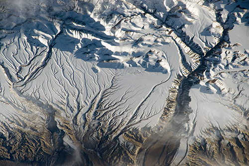 "<div class=""meta image-caption""><div class=""origin-logo origin-image none""><span>none</span></div><span class=""caption-text"">The Himalaya range, near the China-India border, where peaks cast strong evening shadows on the snow. (NASA)</span></div>"