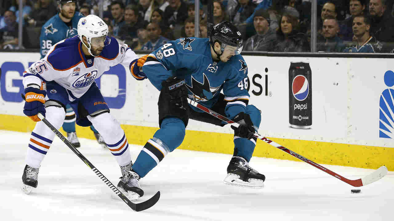 San Jose Sharks center Tomas Hertl moves the puck past Edmonton Oilers defenseman Darnell Nurse on Saturday, April 22, 2017, in San Jose, Calif.