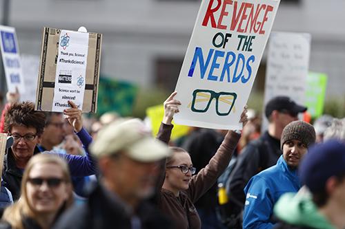 <div class='meta'><div class='origin-logo' data-origin='AP'></div><span class='caption-text' data-credit='AP Photo/David Zalubowski'>Protesters carry signs during a march for science Saturday, April 22, 2017, in Denver.</span></div>